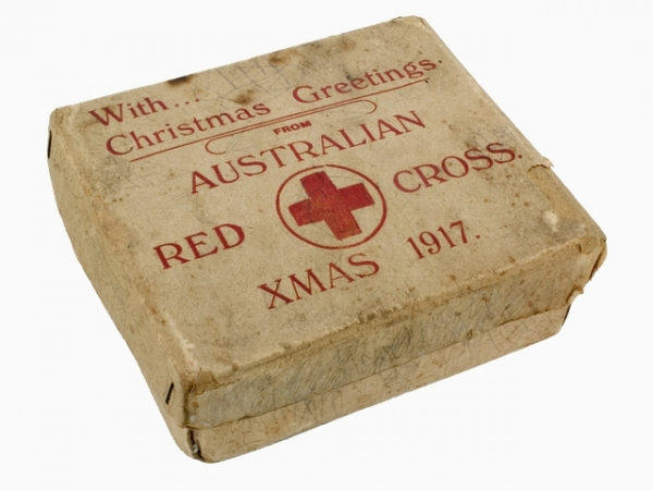 cardboard box with red cross logo on it